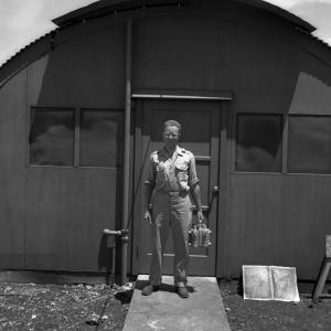 Bernard Waldman with the core of the Fat Man plutonium bomb. Photo courtesy the Walter Goodman Collection, AHF.