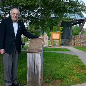 Manhattan Project veteran Bill Wilcox with the International Friendship Bell in its old pavilion in 2008