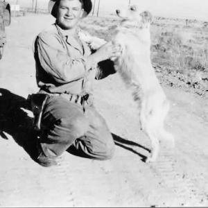 Davis with Whitey the dog, Trinity 1945