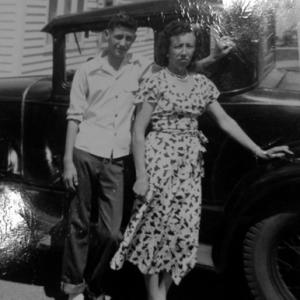 Dimas and his aunt with his father's Model Ford, 1950