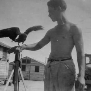 Felix DePaula with pet crow, Trinity 1945