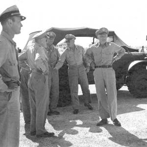 General Carl Spaatz awaits the return of the Enola Gay from its mission
