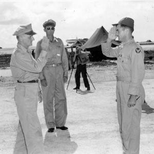 General Spaatz Presents Distinguished Service Cross to Col. Paul Tibbets as General Davies Looks On