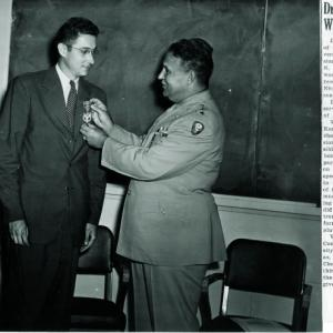General Leslie R. Groves awarding Joseph W. Kennedy the Medal for Merit