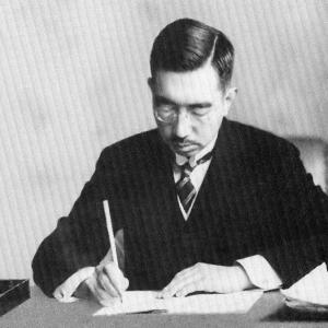 Hirohito signing Japan's post-war constitution