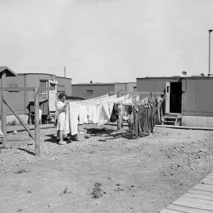 A woman doing laundry at Los Alamos, c. 1945. Photograph courtesy of Los Alamos National Laboratory Archives.