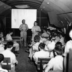 "Capt. William ""Deak"" Parsons and Col. Paul Tibbets briefing the 509th Composite Group crews"