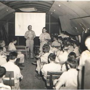 Deak Parsons and Paul Tibbets briefing the 509th on their mission