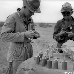 Benjamin C. Benjamin (L) and George Economou (R) preparing Torpex charges for shock velocity determinations at the Trinity Site
