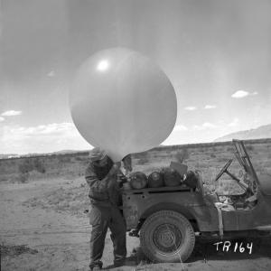 George Economou inflating a balloon to be used to raise primacord at the Trinity Site