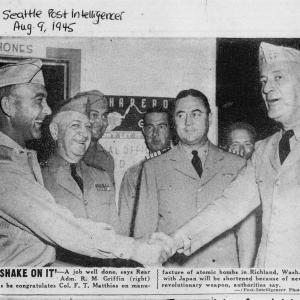 Colonel Franklin Matthias accepts congratulations in a photograph for the Seattle Post-Intelligencer, August 9, 1945. Major Riley is third from left.