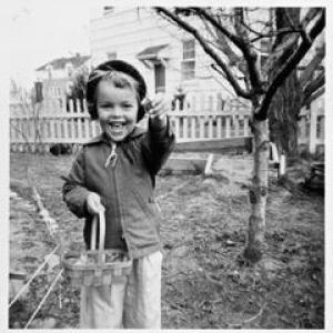 Trisha on an Easter Egg hunt in the backyard of her family's F house in Richland