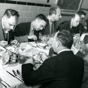 Beall (far right) having a meal with Alvin Weinberg, Hans Bethe, Eugene Wigner, and other scientists. Photo courtesy of Sam Beall.