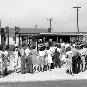 Ed Westcott's photo of workers at the Y-12 plant waiting to punch their time cards, June 23, 1945.