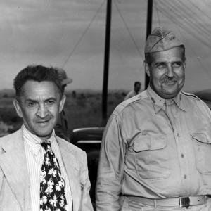 William L. Laurence and General Leslie R. Groves after the Trinity test. Photo courtesy of the Patricia Cox Owen Collection.
