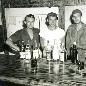 One of the photographs from the collection. This photo of Jack (center) was taken in 1947, during his time at the Marshall Islands.
