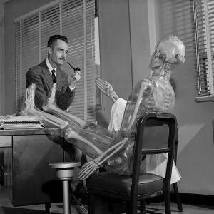 Wright Langham and a plastic skeleton used for plutonium research