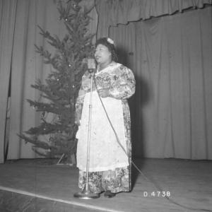Black female performer during Christmas at Hanford