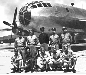 Crew posing in front of Bockscar before the atomic mission. Dehart is pictured on the far left in the front row.