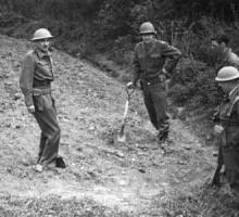 Michael Perrin, John Lansdale Jr., Samuel Goudsmit, and Eric Welsh search for uranium in a field in Haigerloch, Germany