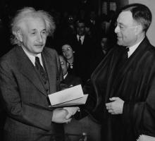 Albert Einstein receiving his his certificate of U.S. citizenship in 1940 from Judge Philip Forman. Photo courtesy Al Aumuller/Library of Congress.