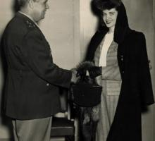 Patty Cox Owen receiving an award from General Groves for her work on the Manhattan Project, March 28, 1947