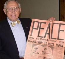 Bill Wilcox with an original copy of the Knoxville Journal announcing the end of the war