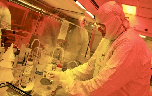 Scientist Phil Evans in a clean at the Center for Nanophase Materials Sciences at ORNL. Photo courtesy of DOE.