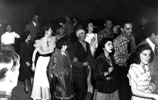 Manhattan Project scientists at a Pueblo dance. Photo courtesy of the Los Alamos History Museum Archives.