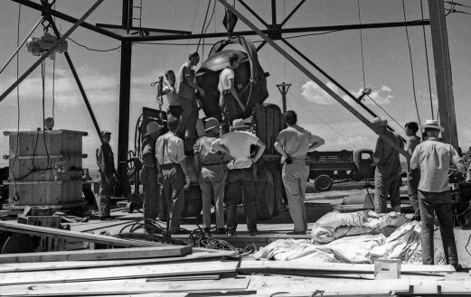 "Manhattan Project workers preparing the ""Gadget"" to be hoisted to the top of the tower."