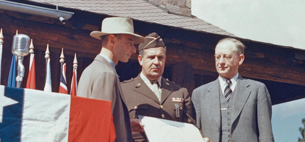 J. Robert Oppenheimer, General Leslie Groves, and UCal President Robert Sproul accepting the Army-Navy E Award for Los Alamos